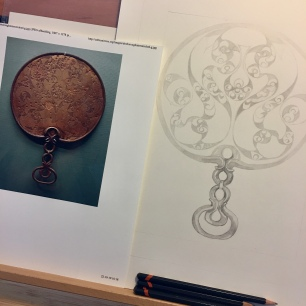 Working on the patterns of Desborough Iron Ago Mirror