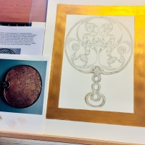 Working on Desborough Iron Age Celtic Mirror; adding a golden border.